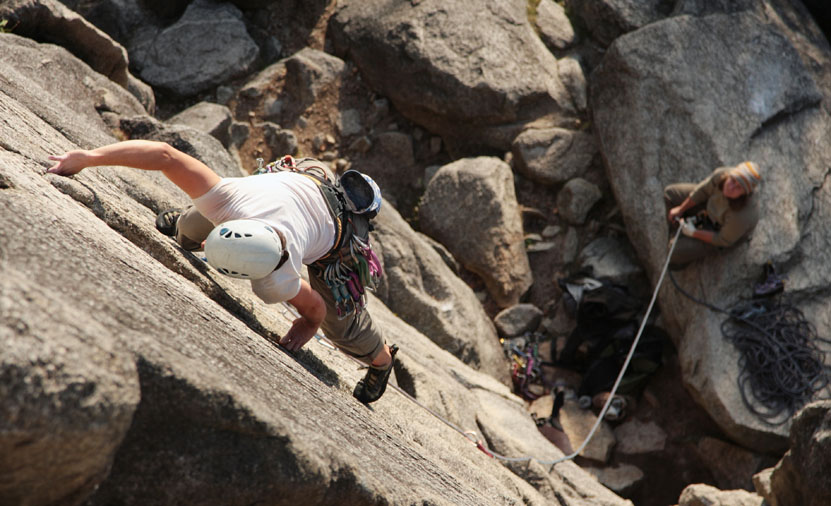 A female climber leads a popular route in Squamish, BC.