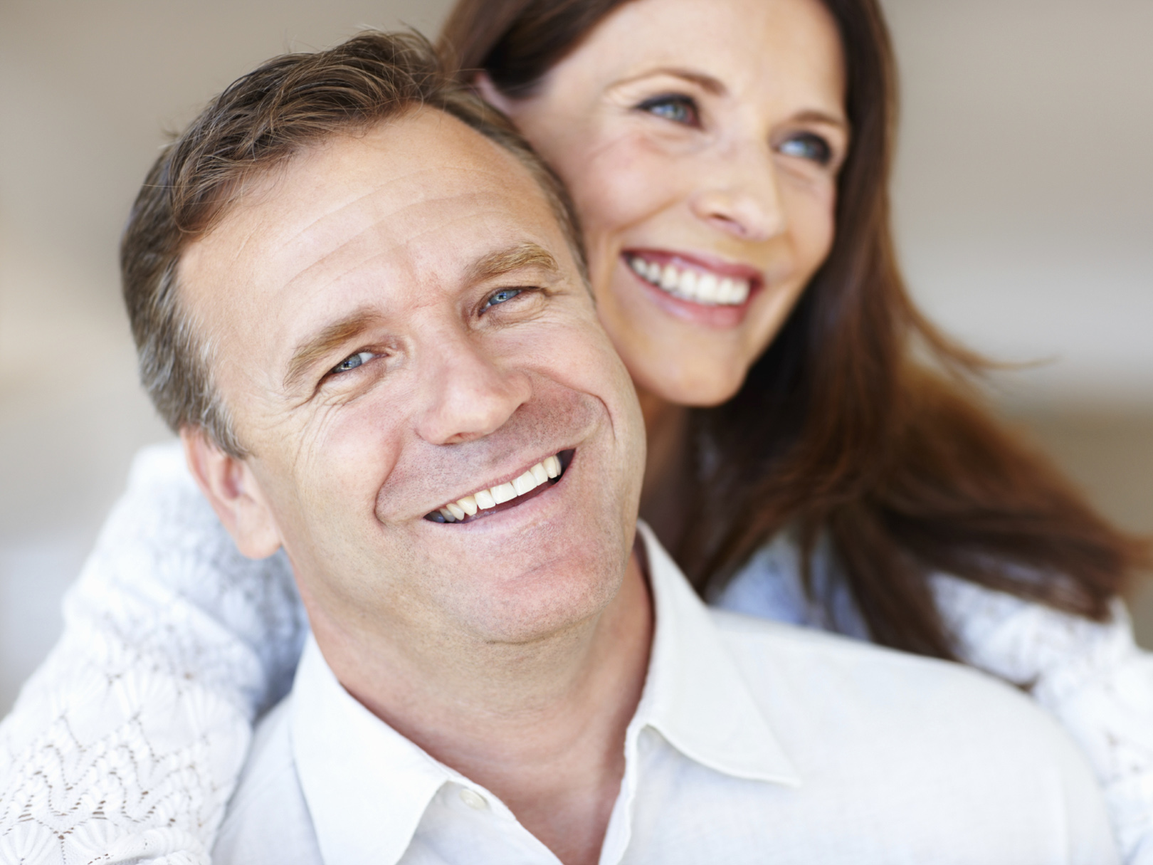 Closeup of relaxed middle age couple spending time together with smile