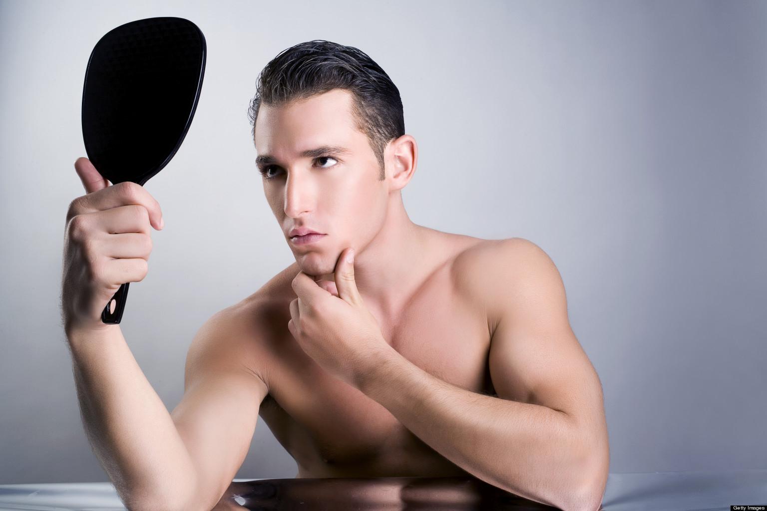 Beauty portrait of man looking in mirror