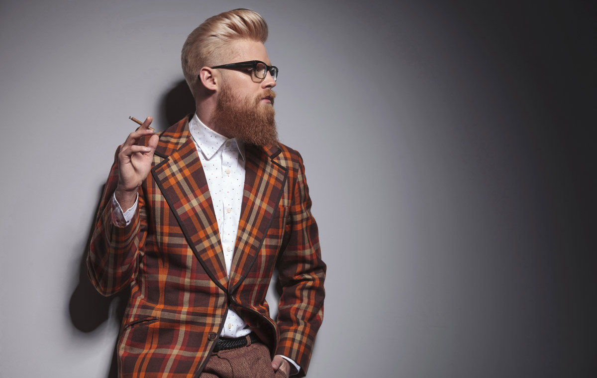cool fashion man with great hairstyle smoking