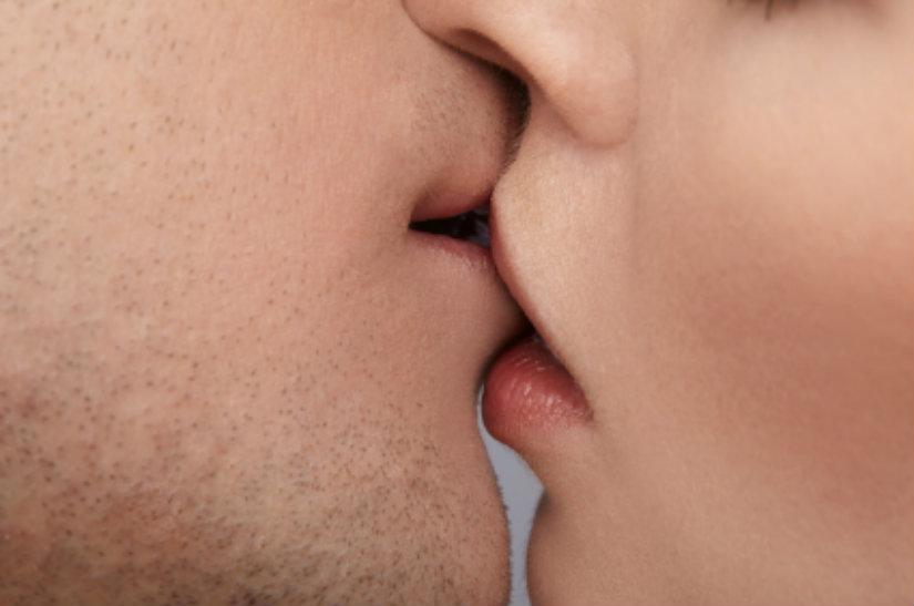 close up portrait of young caucasian couple kissing